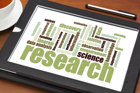 hypothesis: scientific  research word cloud on a digital tablet - science concept Stock Photo