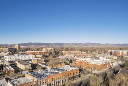 fort collins: FORT COLLINS, CO, USA - MARCH 21, 2015: Aerial view of Fort Collins downtown,  early spring scenery with Front Range of ROcky Mountains in background