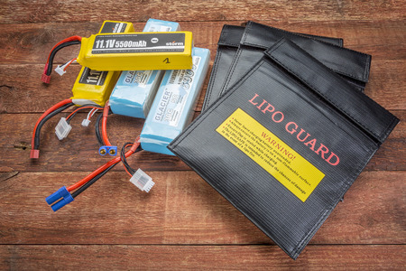 Fort Collins, CO, USA - March 19, 2015:  LiPo (lithium polymer) batteries used in drones and RC model with protective, fireproof, charging bags. Editorial