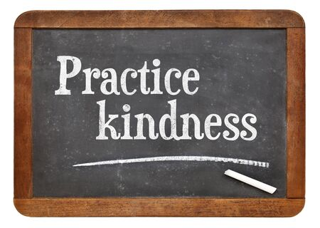 Practice kindness - inspirational advice on a vintage slate blackboard
