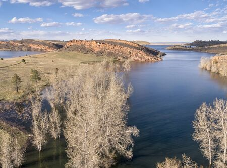 horsetooth reservoir: aerial view of Horsetooth Reservoir near Fort Collins Colorado, early spring with high water level and cottonwood trees in water Stock Photo