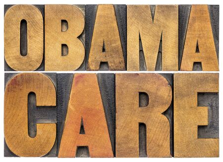 obama care: obamacare typography - isolated word abstract in letterpress wood type