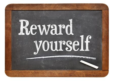 yourself: Reward yourself - motivational words on a vintage slate blackboard Stock Photo