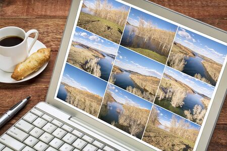 image editing: Reviewing and editing a sequence of time lapse aerial pictures on a laptop - lake landscape in Colorado with a drone shadow.