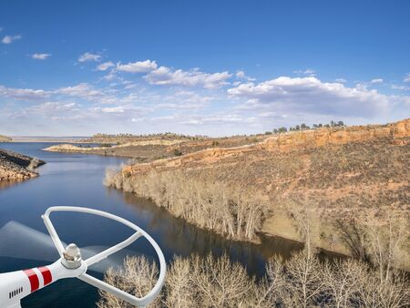 horsetooth reservoir: rotating drone propeller and aerial view of Horsetooth Reservoir near Fort Collins Colorado, in early spring with high water level
