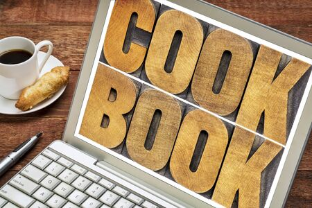 wood type: cookbook word abstract  - text in letterpress wood type on a laptop screen Stock Photo