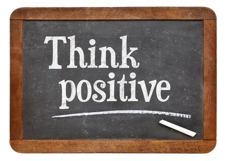 think positive: Think positive - inspirational words on a vintage slate blackboard