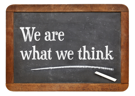 philosophical: We are what we think - philosophical words  on a vintage slate blackboard Stock Photo