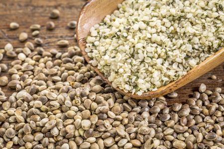 hemp hemp seed: hemp seeds and hearts in a rustic wooden scoop