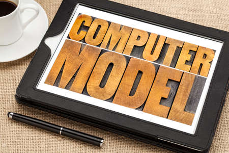 computer model typography - science or research concept -  word abstract in letterpress wood type on a digital tablet Stok Fotoğraf