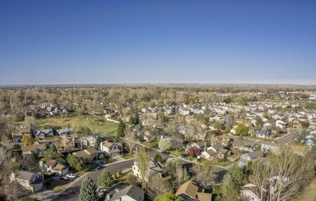 collins: aerial view of Fort Collins residential area, typical along Colorado Front Range, early spring (April) scenery