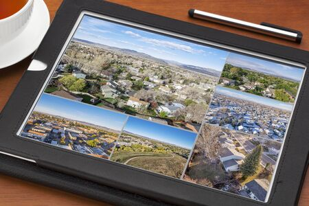 fort collins: Reviewing aerial pictures on a digital tablet - real estate and residential areas of Fort Collins in northern Colorado. All screen images copyright by the photographer. Stock Photo