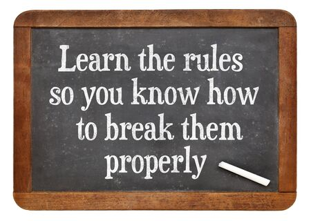 breaking the rules: Learn the rules, so you know hot to break them properly. INspirational words on a vintage slate blackboard