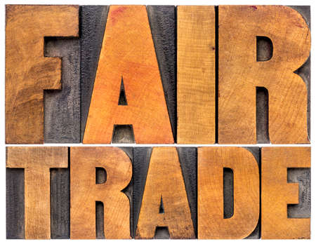 wood trade: fair trade word abstract typography - isolated text in letterpress wood type