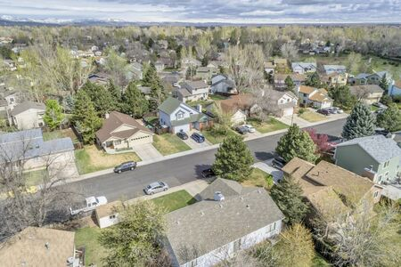 fort collins: FORT COLLINS, CO, USA - APRIL 18, 2015: Aerial view of Fort Collins, a typical residential neighborhood along Front Range of Rocky Mountains in Colorado,  early spring Editorial