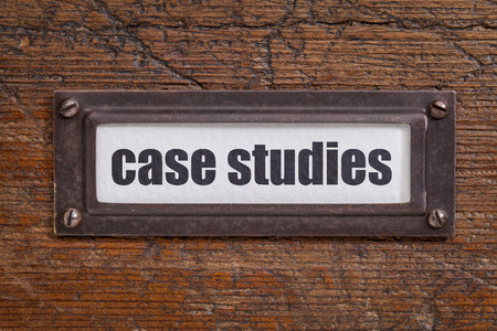 case studies  - file cabinet label, bronze holder against grunge and scratched wood Stock Photo - 39219033