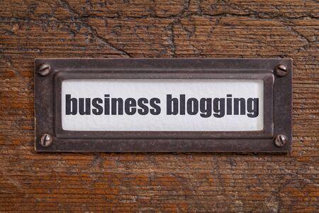 file cabinet: business blogging  - file cabinet label, bronze holder against grunge and scratched wood