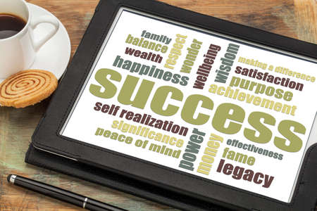self realization: success word cloud on a digital tablet with a cup of coffee