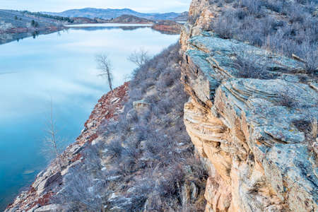 horsetooth reservoir: winter dusk over mountain lake with sandstone cliffs - Horsetooth Reservoir near Fort Collins, Colorado
