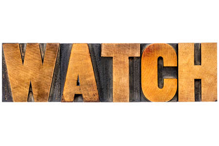 watch word typography - isolated text in letterpress wood type blocks photo