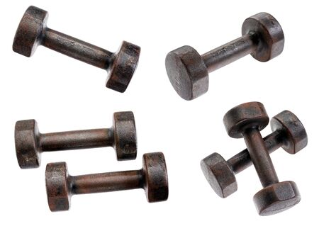 old  rusty dumbbells isolated on white with clipping paths - a collage of four pictures Banco de Imagens