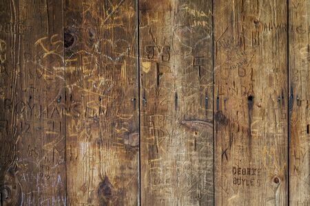 vandal: vandal graffiti on a wood wall of historic structure (covered bridge)