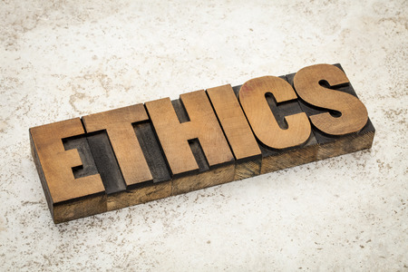 ethics word in vintage letterpress wood type on a ceramic tile background photo
