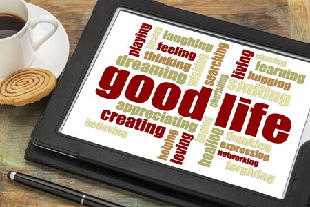 good life: good life - cloud of positive words  on a digital tablet with a cup of coffee Stock Photo