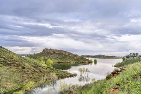 collins: mountain lake at springtime with high water level - Horsetooth Reservoir near Fort Collins, Colorado Stock Photo