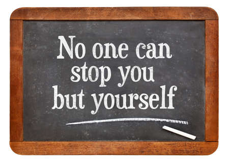 yourself: No one can stop you but yourself. Motivational text on a vintage slate blackboard Stock Photo