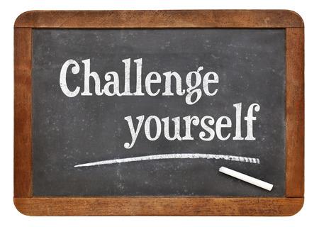 yourself: Challenge yourself - motivational text  on a vintage slate blackboard