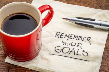 setting goals: remember your goals - handwriting on a napkin with a cup of epsresso coffee Stock Photo