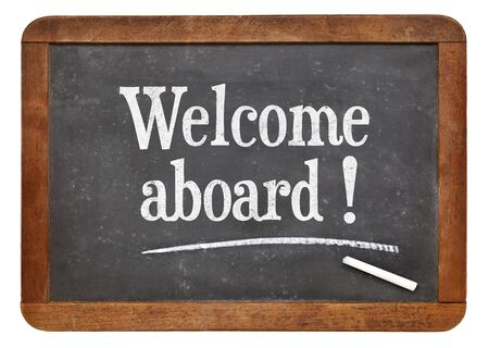 aboard: Welcome aboard - text  on a vintage slate blackboard Stock Photo