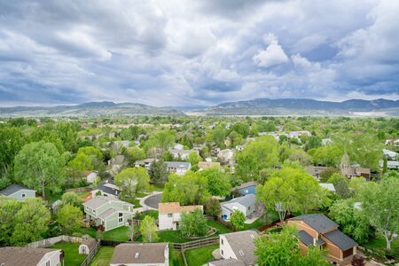 rocky mountains colorado: aerial view of resdential area and foothills of Rocky Mountains at springtime - Fort Collins, Colorado