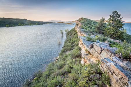 sagebrush: sandstone cliff and lake at dusk - Horsetooth Reservoir near Fort Collins, Colorado, at springtime