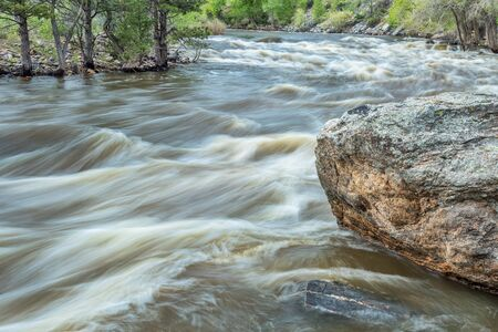 cache la poudre river: Cache la Poudre River at spring run off, a popular among whitewater kayakers, Filter Plant section, near Fort Collins, Colorado