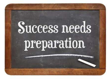 Success needs preparation - motivational text on a vintage slate blackboard