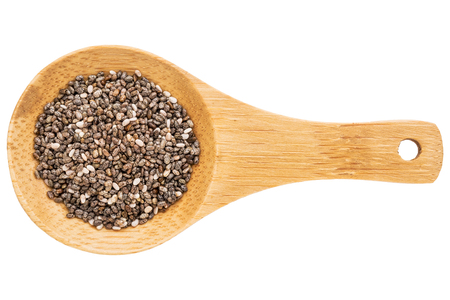 hispanica: chia seeds on a small wooden spoon isolated on white with a clipping path