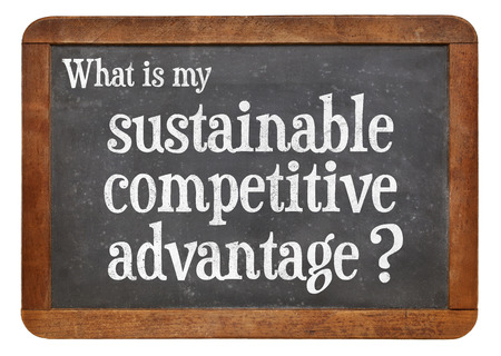 What is my sustainable competitive advantage question? A question on a vintage blackboard isolated on white, Banco de Imagens
