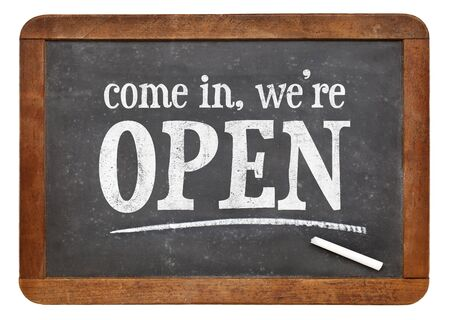come in: Come in, we are open - invitation on a vintage slate blackboard