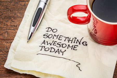 Do something awesome today handwriting on a napkin 스톡 콘텐츠