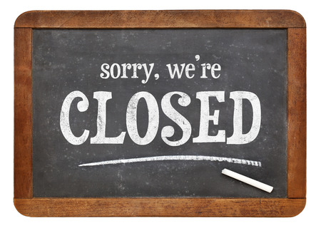 sorry: Sorry, we are closed - text on a vintage slate blackboard
