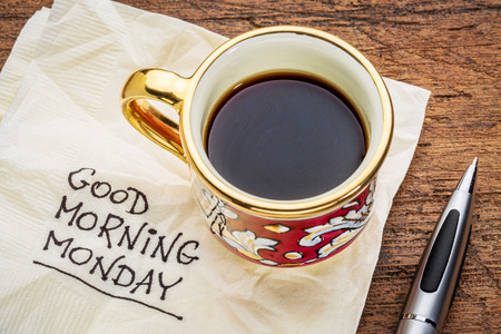 monday: Good morning, Monday - handwriting on a napkin with a cup of coffee