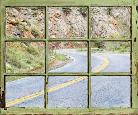 sash: travel concept - a view of windy mountain road  through vintage, grunge, sash window with dirty glass