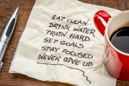 healthy lifestyle tips - handwriting on a napkin with a cup of coffee 写真素材