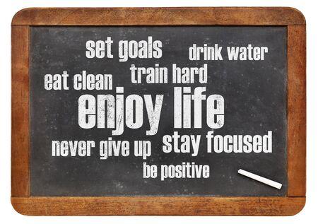 enjoy life: enjoy life - healthy lifestyle word cloud on a vintage blackboard Stock Photo