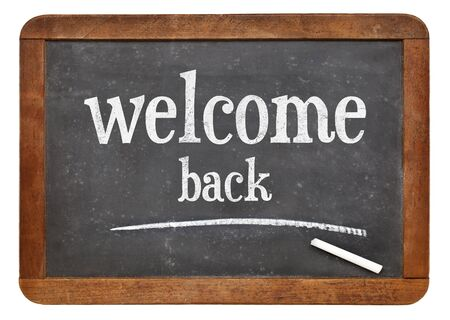 vintage sign: Welcome back sign - text on a vintage slate blackboard Stock Photo