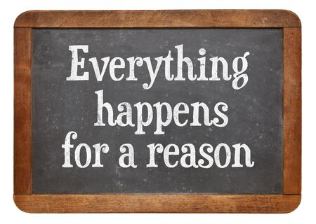 reason: Everything  happens for a reason - text on a vintage slate blackboard Stock Photo