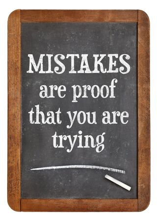 mistakes: Mistakes are proof that you are trying - motivational text on a vintage slate blackboard