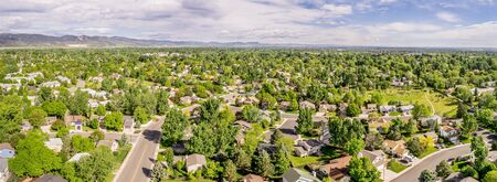 collins: aerial panorama of Fort Collins with downtown and Rocky Mountains in a distance, late spring scenery Stock Photo